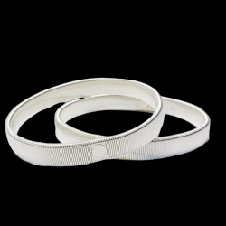 COUPLE OF ARMBANDS SILVER...